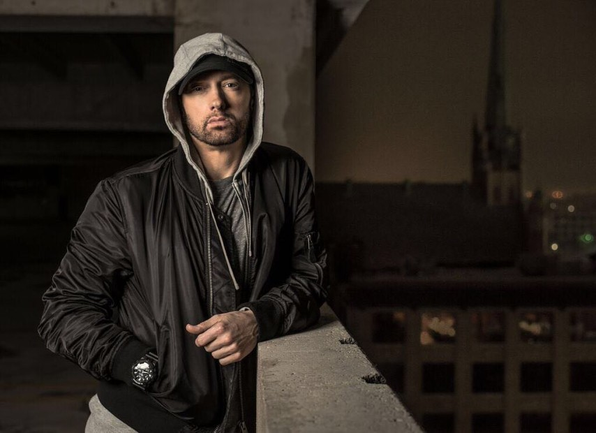 Eminem posing in a hoodie - one of the most influential hip-hop artists of all time